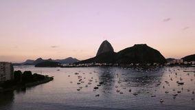 Aerial view of Rio de Janeiro, Brazil. Sugar loaf mountain by sunset. Christ the redeemer