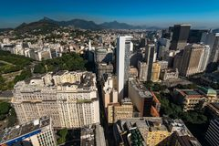 View of Rio de Janeiro Downtown Buildings, and Mountains in the Horizon. Aerial view of Rio de Janeiro city downtown buildings and Tijuca forest mountains in the royalty free stock image