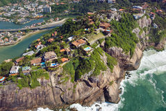 Aerial view of the Rio De Janeiro Coast. Aerial view of luxury homes perched on a cliffside in Rio De Janeiro Royalty Free Stock Photos