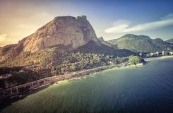 Aerial view of Rio de Janeiro's Pedra da Gavea Mountain with two Stock Photography