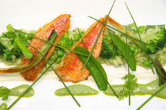 Aerial view of a risotto with red mullet fish, asparagus broccol Stock Photos