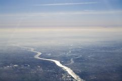 Aerial view of river. An aerial view of sunlight reflecting from a river below stock photography