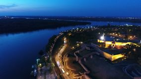 Aerial view of a river bank and city outscirt in night stock video footage