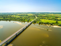 Aerial view of river and bridge. Bridge, road and countryside. Royalty Free Stock Photo