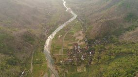 River in mountain canyon. Aerial view river canyon among farm lands rice terraces. river in mountain canyon, gorge, among hills covered with vegetation, trees at stock video