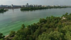 Aerial view river going yacht stock footage
