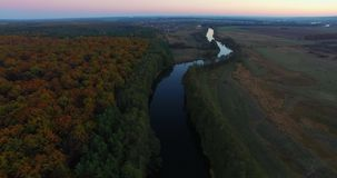 Aerial view the river on green forest plain. stock footage