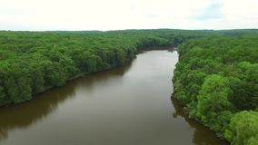 Aerial view the river on green forest plain.. stock footage