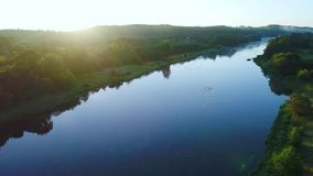 Aerial landcape of river in green meadows stock video footage