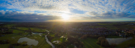 Aerial view of a river and a lake in wintertime. Panoramic view of a river and a lake in wintertime  in the UK Royalty Free Stock Photography