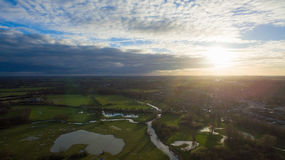 Aerial view of a river and a lake in wintertime. Sunset Drone view of a river and a lake in wintertime  in the UK Stock Photography