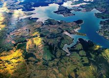 Aerial view of river and land. And mountains stock images