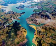 Aerial view of river and land. And mountains royalty free stock photos