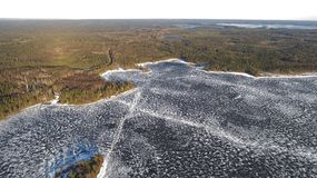 Aerial view on river with melting ice, sunny spring weather with snow stock photos