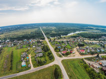 Aerial view of the river Mologa and the village. Shooting with the bird`s eye view of Maksatikhinskiy district of Tver region Royalty Free Stock Image