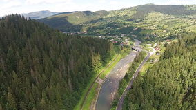 Aerial view of the river near the mountain road with bridge stock footage