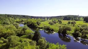 Aerial view of the river near the railway bridge stock footage