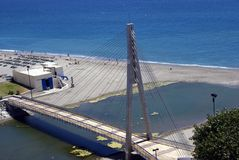 Aerial view of a river & a pedestrian bridge in Fuengirola, Andalusia, Spain, Europe Royalty Free Stock Image