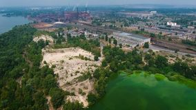 Aerial view of river polluted with green algae near industry zone. Ecology, waste water, environmental problems stock footage