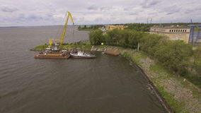 Aerial view:River port with cranes and ships. Aerial:port cargo cranes and ship fragment at the docks.Aerial view:Container cranes in cargo port terminal, cargo stock video footage