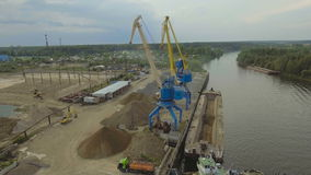 Aerial view:River port with cranes and ships. stock video footage