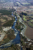 Aerial view of the river beside the road Stock Photo