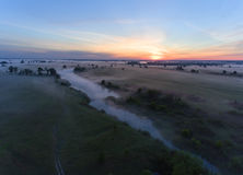 Aerial view of river at sunrise, fly over morning mist on the river Stock Images