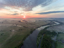 Aerial view of river at sunrise, fly over morning mist on the river Stock Photography