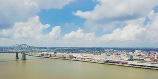 Aerial view riverside downtown New Orleans, Louisiana, USA. Aerial view of Crescent City Connection and riverside Downtown New Orleans again cloud blue sky Royalty Free Stock Images