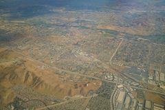 Aerial view of Riverside, view from window seat in an airplane. California, U.S.A Royalty Free Stock Photos
