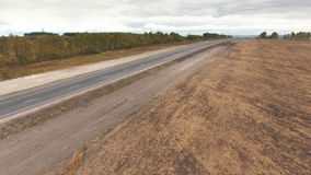 Aerial view of road in field stock footage