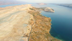 Aerial view of road through barren landscape of Pag island in Croatia. Aerial view of road through barren landscape of Pag island in Dalmatia,Croatia stock video