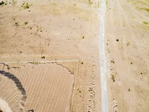 Aerial view of road with car. Aerial view of a country road with sand. Car passing by. Aerial construction road. Aerial view flyin royalty free stock photos