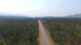 Aerial View Road In The Coniferous Forest On Lake Baikal, Buryatia, Russia. Aerial View Road In The Coniferous Forest On Lake Baikal, Buryatia stock footage