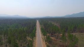 Aerial View Road In The Coniferous Forest On Lake Baikal, Buryatia, Russia. Aerial View Road In The Coniferous Forest On Lake Baikal, Buryatia stock video footage