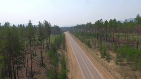 Aerial View Road In The Coniferous Forest On Lake Baikal, Buryatia, Russia. Aerial View Road In The Coniferous Forest On Lake Baikal, Buryatia stock video