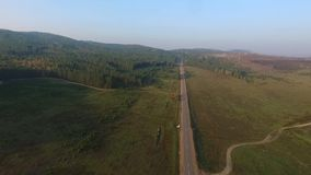 Aerial View Road In The Coniferous Forest On Lake Baikal, Buryatia, Russia stock video footage