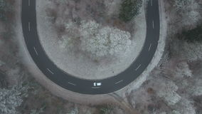Aerial view of a road curve in the forest stock footage