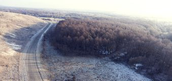Aerial view on road and forest landscape in winter season. Stock Images