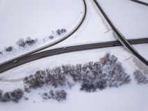 Aerial view on road and forest landscape in winter season stock image