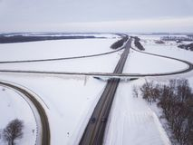 Aerial view on road and forest landscape in winter season.  royalty free stock photo