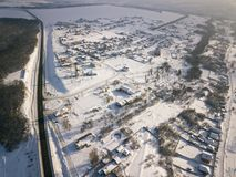Aerial view on road and forest landscape in winter season.  stock image