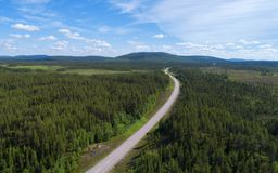 Aerial view of road and forest in scandinavia. Summer panorama royalty free stock photography