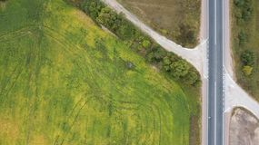 Aerial view of a road in a green field royalty free stock image