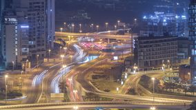 Aerial view of a road intersection in a big city night timelapse. Urban landscape of Dubai Marina district in UAE with cars and skyscrapers stock footage