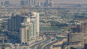 Aerial view of a road intersection in a big city timelapse. Urban landscape of Dubai Marina and JLT district in UAE with cars and skyscrapers stock video