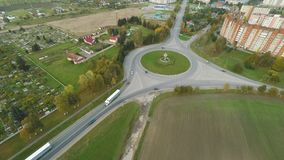 Aerial view road junction of five roads. Aerial of the outskirts of the city of Lida. Residential neighborhood. Belarus stock video footage