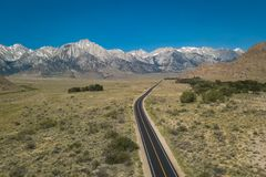 Aerial View of a road leading to Sierra Nevada Mountains royalty free stock photos