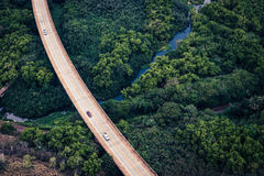 Aerial view of the road in lush green forest, Kauai, Hawaii Royalty Free Stock Photography