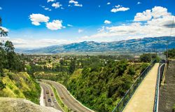 Aerial view of road in the mountains to visit the municipal dump in a beautiful day, in the city of Quito, Ecuador Stock Photos